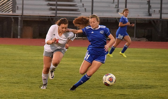 Mingus senior Jaiden Behlow dribbles past a Falcon during the Marauders' 8-0 loss at Catalina Foothills on Tuesday. VVN/James Kelley