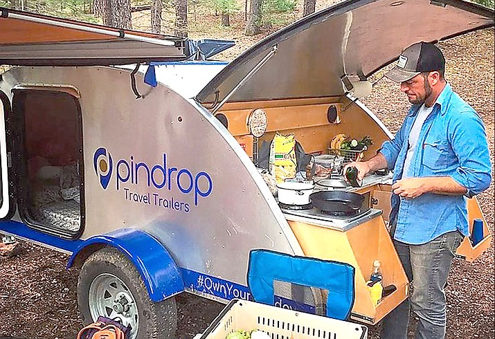 Cottonwood Mayor Tim Elinski is seen camping with his Pin Drop Travel Trailer in publicity photos from their website. Photo courtesy Tim Elinski
