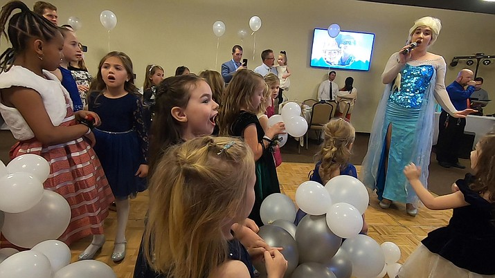 """Elsa from Disney's """"Frozen"""" movies sings songs from the films for the young girls at the 2020 Daddy-Daughter Date Night in Prescott Valley on Friday, Feb. 22, 2020 (Jesse Bertel/Courier)"""