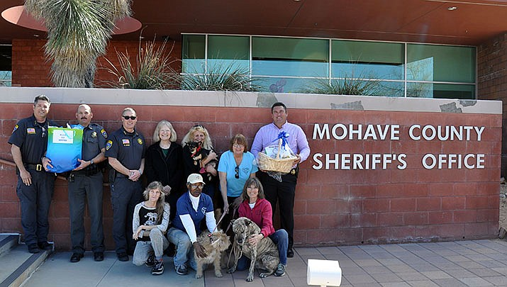 For The Luv of Paws shelter founder Cherie Dalynn and her volunteers from the domestic animal shelter and sanctuary in Golden Valley drop off a Valentine's Day basket for the Mohave County Sheriff's Office employees and a basket for the office's five K-9s. (Photo by Butch Meriwether/For the Miner)