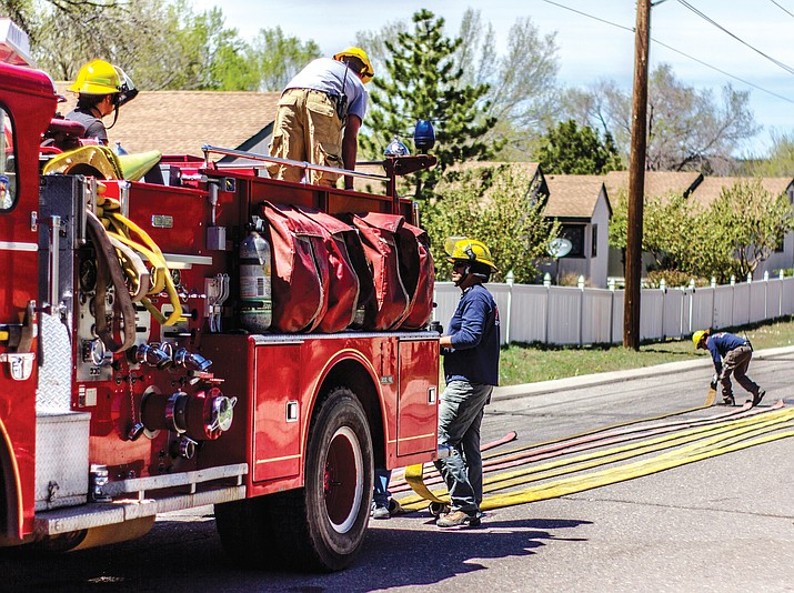 Williams Volunteer Fire Department tests more than 10,900 feet (over two miles) of fire hose in April 2019. Firefighters responded to 186 calls for service in 2019. Their efforts were recently recognized by the Williams City Council. (Photo courtesy of Cris Acosta)
