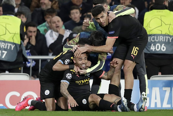 Manchester City's Gabriel Jesus celebrates with teammates after scoring his side's first goal during the round of 16 first leg Champions League match between Real Madrid and Manchester City at the Santiago Bernabeu stadium in Madrid, Spain, Wednesday, Feb. 26, 2020. (Bernat Armangue/AP)