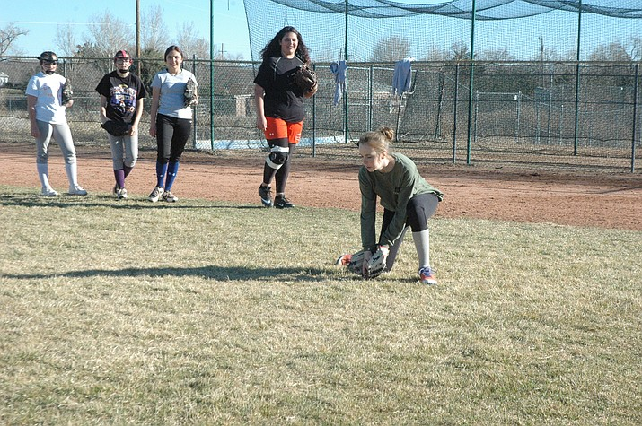 Talia Stuller, right, fields a ground ball that was thrown to her during practice Wednesday, Feb. 26., in Chino Valley. (Jason Wheeler/Courier)
