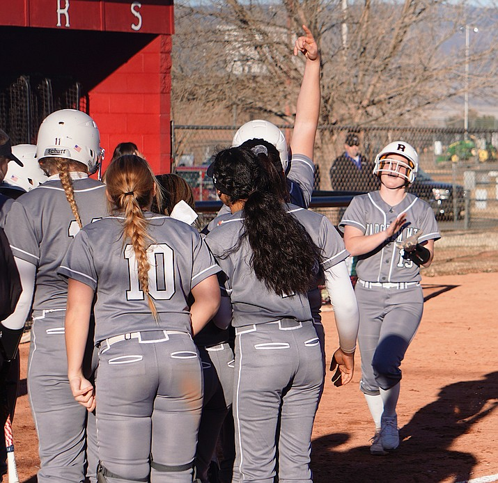 Bradshaw Mountain softball greets Caitlynn Neal (19) at home plate after she hit a home run and rounded the bases during a game against Youngker on Wednesday, Feb. 26, 2020, in Prescott Valley. (Aaron Valdez/Courier, file)