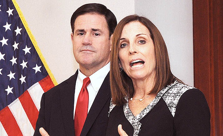 U.S. Sen. Martha McSally can keep the seat she was given by Gov. Doug Ducey, background, through at least the end of 2020, the 9th Circuit Court of Appeals ruled Thursday. (Capitol Media Services/Howard Fischer file photo)