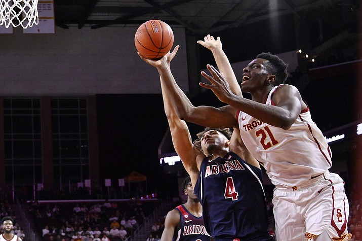 Southern California forward Onyeka Okongwu, right, shoots as Arizona center Chase Jeter defends during the second half of an NCAA college basketball game Thursday, Feb. 27, 2020, in Los Angeles. USC won 57-48. (AP Photo/Mark J. Terrill)