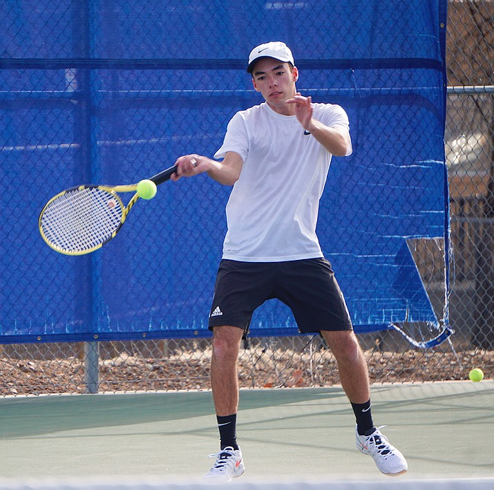 Prescott's Sam Stoecker returns a serve during a practice on Thursday, Feb. 27, 2020, at the Prescott tennis courts. Stoecker is expected to be the No. 1-seeded player for the Badgers in the upcoming season. (Aaron Valdez/Courier)