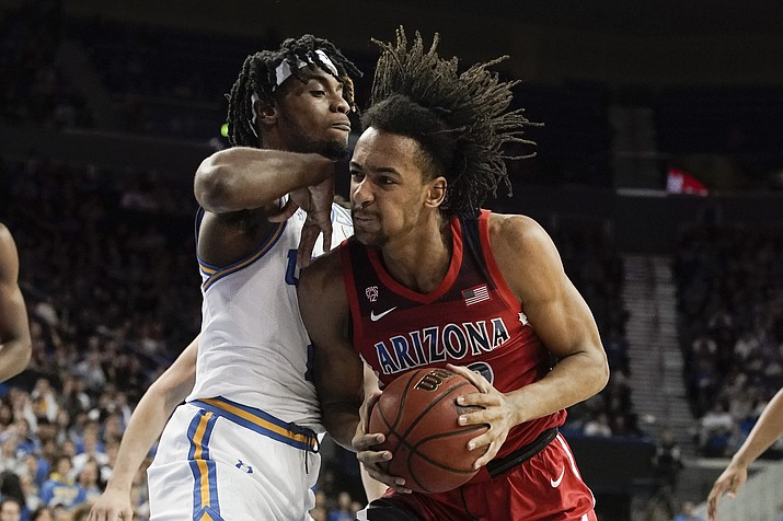 Arizona forward Zeke Nnaji, right, drives to the basket around UCLA forward Jalen Hill during the first half of a game in Los Angeles, Saturday, Feb. 29, 2020. (Chris Carlson/AP)