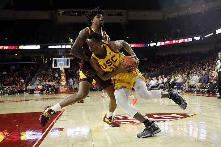 Southern California forward Onyeka Okongwu (21) is defended by Arizona State forward Romello White during the first half of a game Saturday, Feb. 29, 2020, in Los Angeles. (Marcio Jose Sanchez/AP)