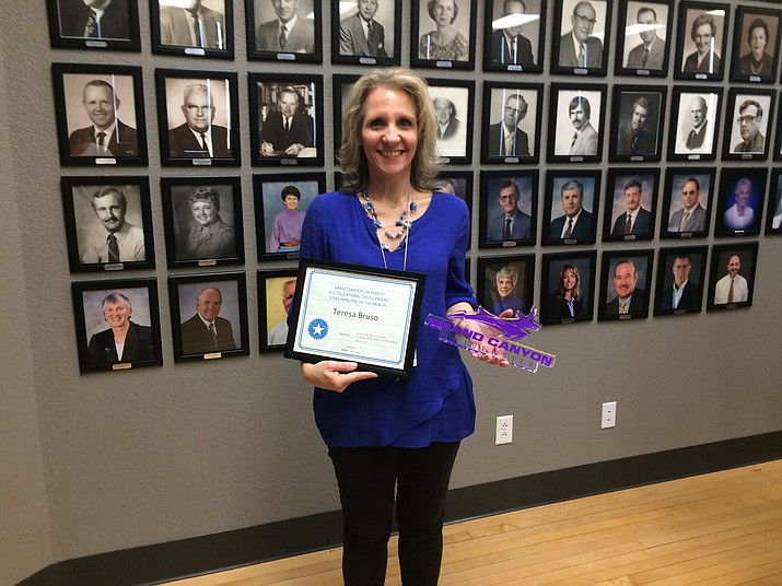 Teresa Bruso is seen with her certificate and Grand Canyon University gifts as part of her honor as principal of the month. (Nanci Hutson/Courier)