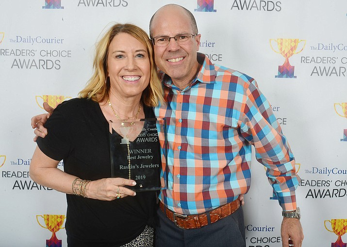 "Renee and Greg Raskin pose with their ""Best Jewelry Store"" award at the 2019 Readers' Choice Awards. (Les Stukenberg/Courier, file)"