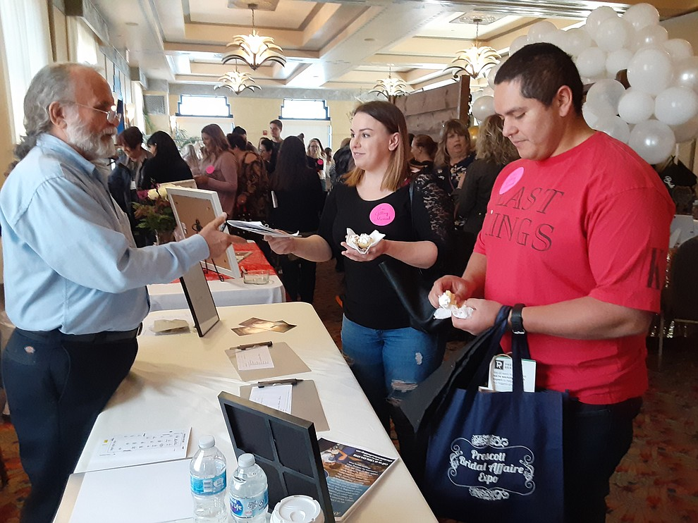 Taylor Schaar and Miguel Alvarez speak to Minister Joel Boyd of Affordable Sedona Weddings at the 2020 Prescott Bridal Affaire Expo at Hassayampa Inn Sunday, March 1, 2020. (Jason Wheeler/Courier)