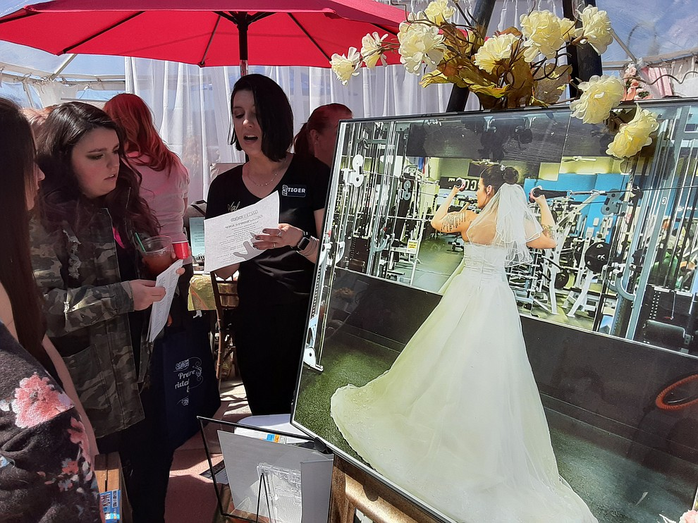 Veronica McTiernan speaks with Tiger Carreras of Bridal Boot Camp at the 2020 Prescott Bridal Affaire Expo at Hassayampa Inn Sunday, March 1, 2020. (Jason Wheeler/Courier)