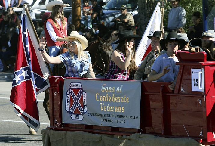 "In this Feb. 20, 2020 photo, the Sons of Confederate Veterans float participates in the 2020 La Fiesta de los Vaqueros Tucson Rodeo Parade in Tucson, Ariz. The city's mayor and a newly elected councilwoman are calling for the removal of Confederate flags from the annual Tucson Rodeo Parade. Mayor Regina Romero said in a prepared statement that the Confederate flag ""has no place in the rodeo parade or elsewhere in our community. (Rick WileyArizona Daily Star via AP)"