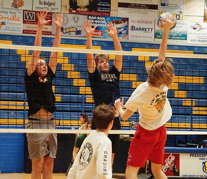 Prescott Jacob Brown goes up for the hit while Dylan Knotek and Trey Koehler go for the block during a practice on Thursday, Feb. 27, 2020, at Prescott's dome gym. (Aaron Valdez/Courier)