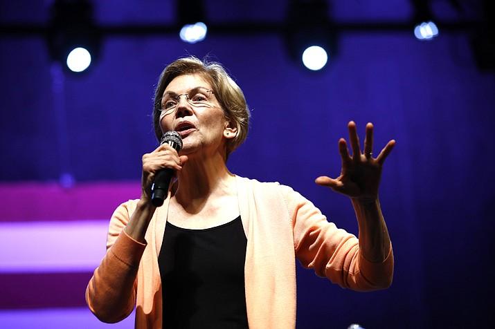 Democratic presidential candidate Sen. Elizabeth Warren, D-Mass., speaks at a campaign event with performer John Legend, Wednesday, Feb. 26, at Charleston Music Hall in Charleston, South Carolina.  (AP Photo/Patrick Semansky)