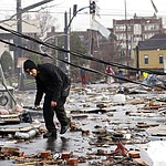 A man walks through storm debris following a deadly tornado Tuesday, March 3, 2020, in Nashville, Tenn. Tornadoes ripped across Tennessee early Tuesday, shredding buildings and killing multiple people. (AP Photo/Mark Humphrey)