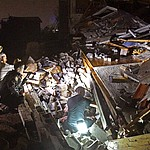 Rescue workers work to free Bill and Shirley Wallace from their home that collapsed and trappedthem under rubble after a tornado hit Mt. Juliet, Tenn., Tuesday, March 3 2020. (Larry McCormack/The Tennessean via AP)