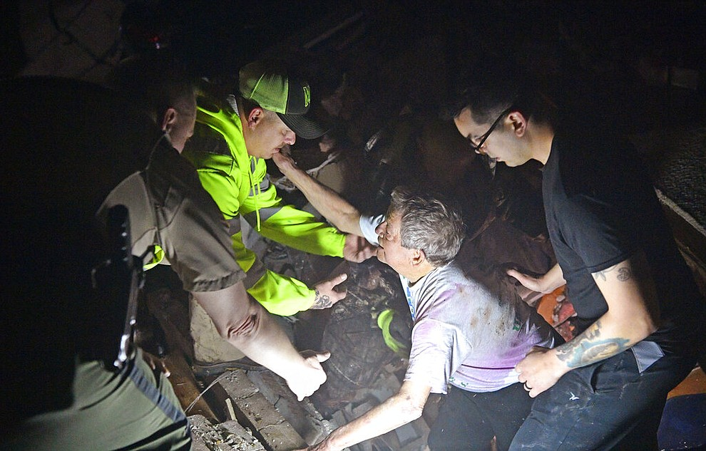 Bill Wallace reaches out to rescue workers who freed him from his home that collapsed on him and his wife Shirley trapping them under rubble after a tornado hit Mt. Juliet, Tenn., on Tuesday, March 3, 2020. ()Larry McCormack/The Tennessean via AP)