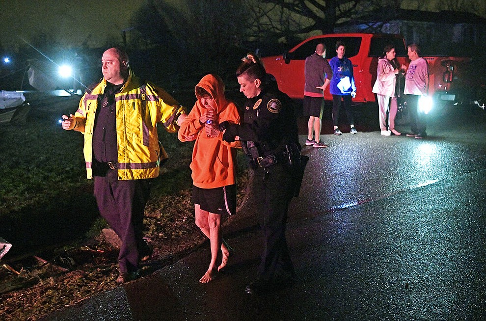 Rescue workers escort Shirley Wallace from her home that collapsed and trapped her under rubble after a tornado hit Mt. Juliet, Tenn., Tuesday, March 3 2020. (Larry McCormack/The Tennessean via AP)