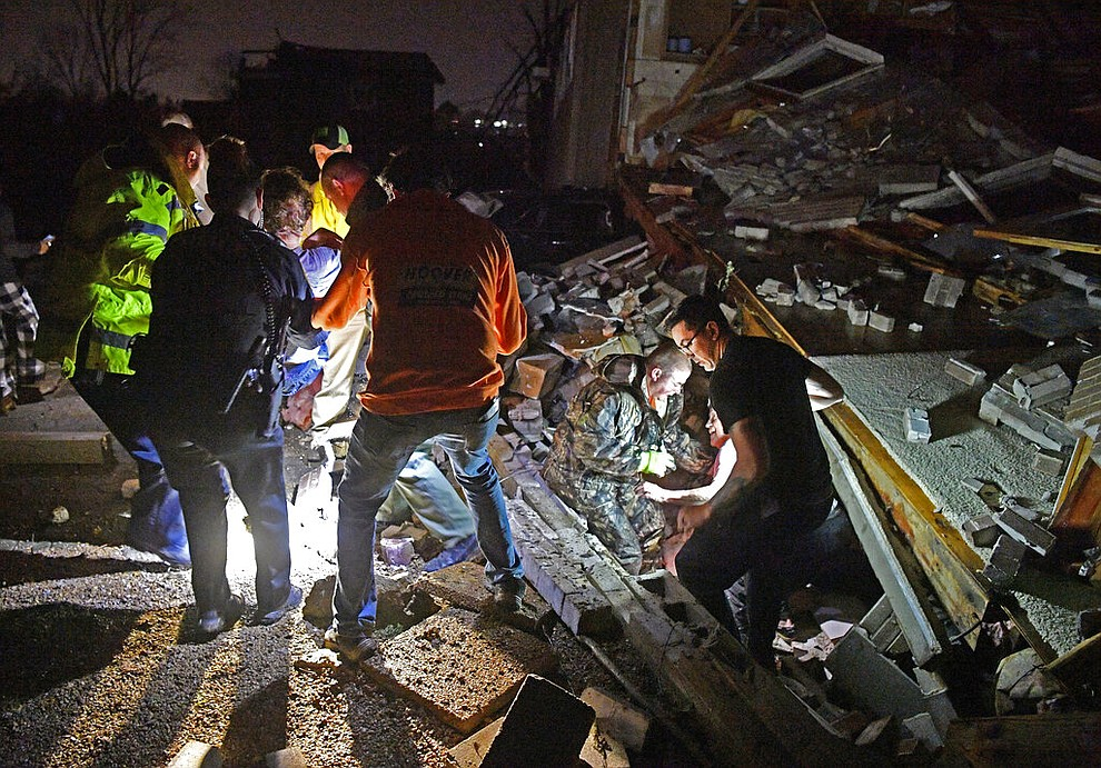 Rescue workers free Bill and Shirley Wallace from their home that collapsed, trapping them under rubble after a tornado hit area Tuesday, March 3 2020, in Mt. Juliet, Tenn. (Larry McCormack/The Tennessean via AP)