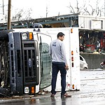 A overturned truck sits in a street in an area damaged by storms Tuesday, March 3, 2020, in Nashville, Tenn.  Tornadoes ripped across Tennessee early Tuesday, shredding buildings and killing multiple people.  (AP Photo/Mark Humphrey)