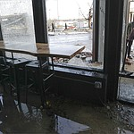 People look in a restaurant damaged by storms Tuesday, March 3, 2020, in Nashville, Tenn. Tornadoes ripped across Tennessee early Tuesday, shredding buildings and killing multiple people.  (AP Photo/Mark Humphrey)