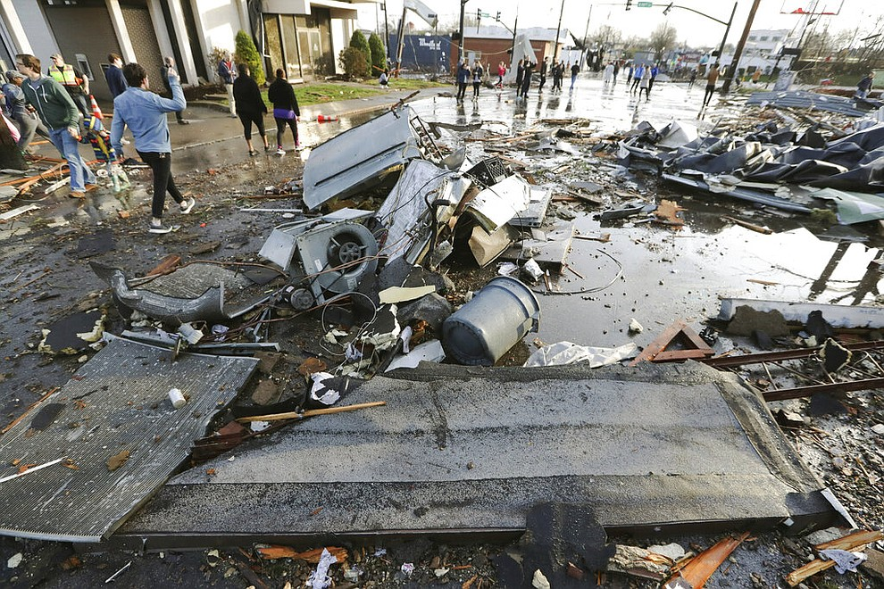 Debris covers a street after overnight storms Tuesday, March 3, 2020, in Nashville, Tenn. Tornadoes ripped across Tennessee early Tuesday, shredding buildings and killing multiple people.  (AP Photo/Mark Humphrey)