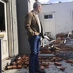 Tennessee Gov. Bill Lee surveys damage to buildings in Nashville, Tenn. on Tuesday, March 3, 2020. Tornadoes ripped across Tennessee early Tuesday, shredding at least 40 buildings and killing many people. One of the twisters caused severe damage across downtown Nashville, destroying the stained glass in a historic church and leaving hundreds of people homeless. (AP Photo/Travis Loller)