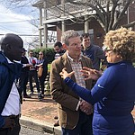 Tennessee Gov. Bill Lee speaks with business owner Mignon Francois, in Nashville, Tenn. on Tuesday, March 3, 2020. Tornadoes ripped across Tennessee early Tuesday, shredding at least 40 buildings and killing many people. One of the twisters caused severe damage across downtown Nashville and leaving hundreds of people homeless. (AP Photo/Travis Loller)