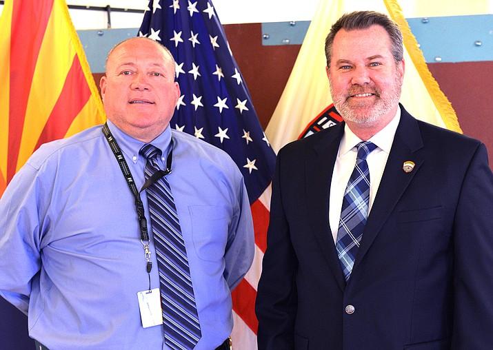 Winslow City Manager John Barkley (right) welcomes Winslow Warden John Mattos Feb. 27. (Todd Roth/NHO)