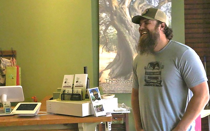 Scott McPeak, owner of the oil and vinegar shop Olive the Best, said increasing the minimum wage gives more incentive to perform well. (Jessi Zorker/Cronkite News)