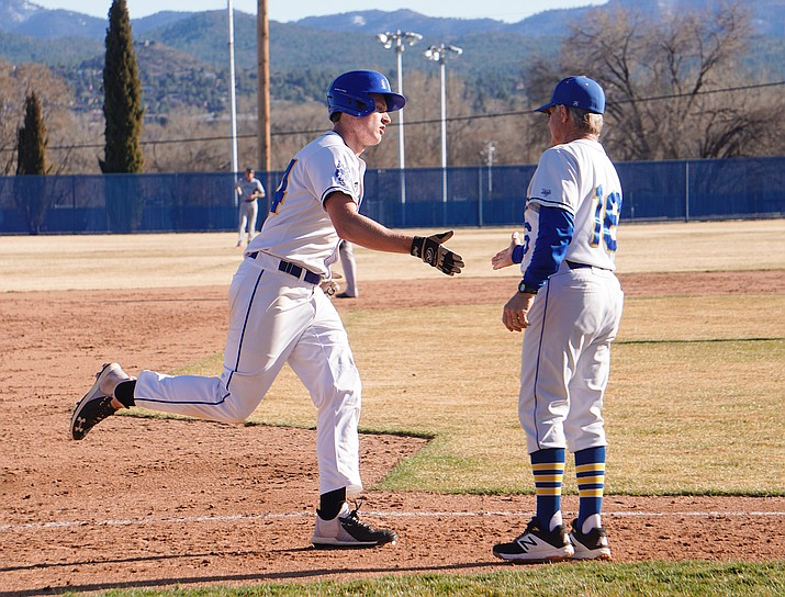 Prescott infielder Korey Schwartz, left, celebrates with head coach Kent Winslow, right, while rounding the bases after hitting a two-run home run during a game against Tempe on Tuesday, March 3, 2020, at Cal Cordes Field in Prescott. (Aaron Valdez/Courier)
