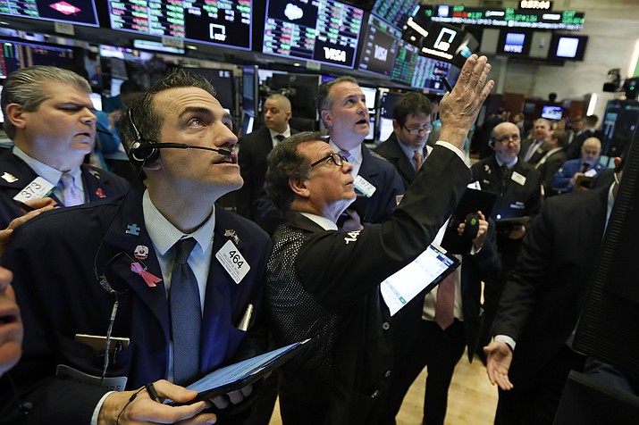 Traders gather at a post on the floor of the New York Stock Exchange, Wednesday, March 4, 2020. Stocks surged in early trading on Wall Street, led by health care stocks after Joe Biden scored a number of Super Tuesday wins. (Richard Drew/AP)