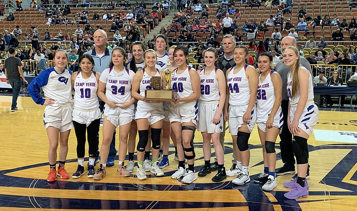 Camp Verde girls basketball poses with the runner-up trophy. The Cowboys also finished second in the state in 2007, 1993 and 1986. VVN/James Kelley