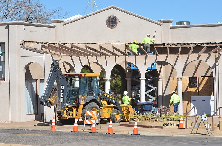The Town of Clarkdale's municipal building, which houses the Public Works Administration and Utility Billing office and the Community Development office, gets its tile roof removed by the Public Works staff on Wednesday in the main intersection of town. This building was originally built in 1926 and was the original home of the US Post Office, explained Maher Hazine, P.E, director of Public Works. The Current roof structure is more than 50 years old. They are taking the current roof apart and rebuilding it to replace deteriorating substructure that has become a hazard, he said. Last year, the town replaced the roof of the Clark Memorial Building including the auditorium, Hazine said. VVN/Vyto Starinskas