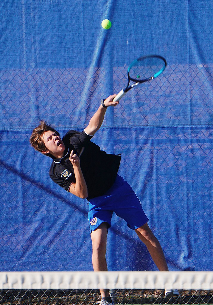 Owen Thomas of Prescott boys tennis serves the ball during a doubles match against Shadow Mountain on Thursday, March 5, 2020, in Prescott. The Badgers won the match 8-1. (Aaron Valdez/Courier)