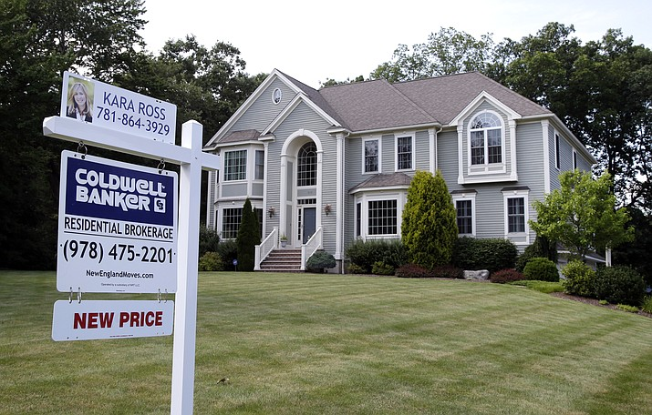 This July 10, 2017, file photo shows a house for sale, in North Andover, Mass. Nearly a third of Americans who've never previously bought a home say they plan to in the next five years, according to a survey commissioned by NerdWallet and conducted online by The Harris Poll among 2,007 U.S. adults in January 2020. (Elise Amendola/AP, file)