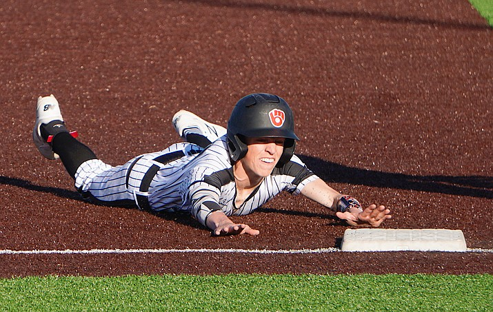 Bradshaw Mountain shortstop Jacob Platt slides to steal third base during a game against Deer Valley on Friday, March 6, 2020, in Prescott Valley. (Aaron Valdez/Courier)