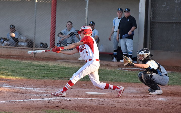 Mingus senior Trevor Hoke hits an RBI double in the Marauders' 11-6 loss to Estrella Foothills  at home on Friday. VVN/James Kelley
