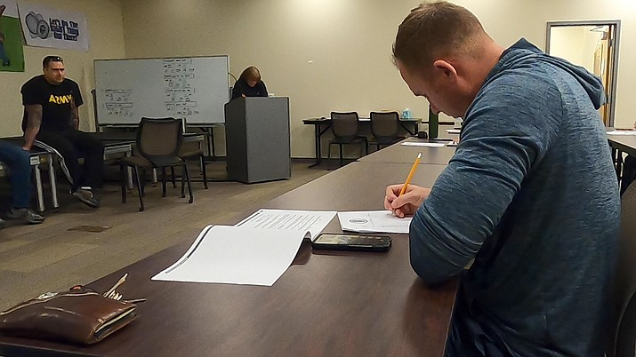 A man wishing to work as an officer for the Prescott Valley Police Department takes the agency's written exam at the department's station on Saturday, March 7, 2020. (Jesse Bertel/Courier)