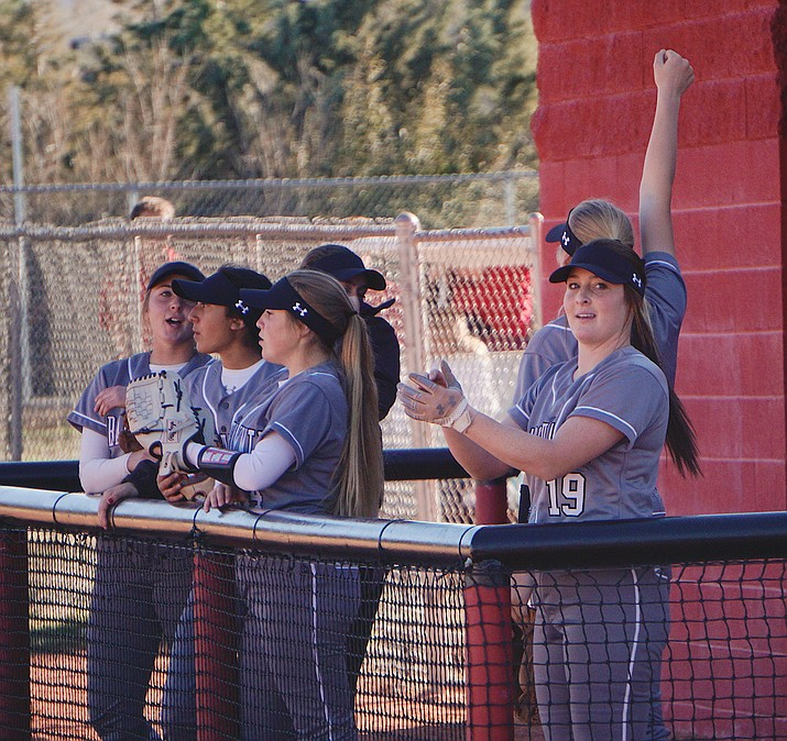 Bradshaw Mountain softball pitcher/shortstop Caitlynn Neal (19) and teammates cheer from the dugout during a game against Youngker on Wednesday, Feb. 26, 2020, in Prescott Valley. (Aaron Valdez/Courier, file)