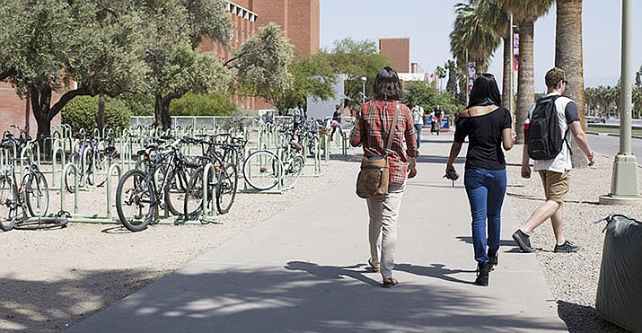 University of Arizona students walk to and from class on the Tucson campus. Universities around the U.S. are implementing new travel restrictions and possible student quarantines to minimize potential exposure to COVID-19. (File photo by Emily L. Mahoney/Cronkite News)