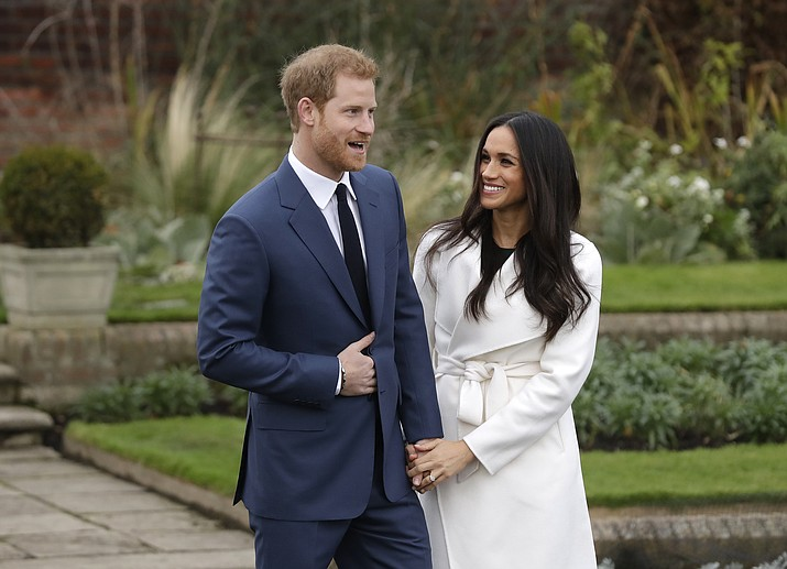In this Monday Nov. 27, 2017 file photo, Britain's Prince Harry and his fiancee Meghan Markle pose for photographers in the grounds of Kensington Palace in London, after announcing their engagement. Prince Harry and his wife, Meghan, are fulfilling their last royal commitment Monday March 9, 2020 when they appear at the annual Commonwealth Service at Westminster Abbey. It is the last time they will be seen at work with the entire Windsor clan before they fly off into self-imposed exile in North America. (Matt Dunham/AP file photo)