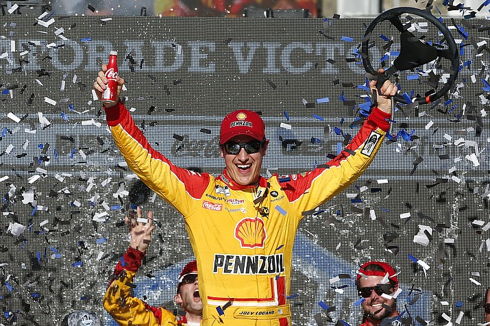 Joey Logano celebrates in Victory Lane after winning a NASCAR Cup Series auto race at Phoenix Raceway, Sunday, March 8, 2020, in Avondale. (AP Photo/Ralph Freso/AP)