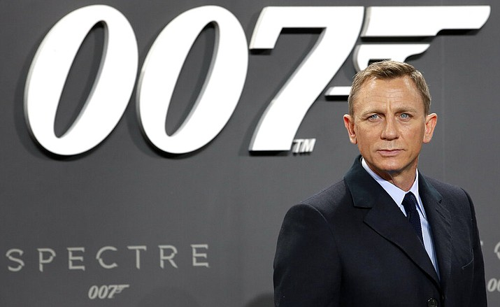 "This is a Wednesday, Oct. 28, 2015 file photo of actor Daniel Craig poses for the media as he arrives for the German premiere of the James Bond movie 'Spectre' in Berlin, Germany. The release of the James Bond film ""No Time To Die"" has been pushed back several months because of global concerns about coronavirus. MGM, Universal and producers Michael G. Wilson and Barbara Broccoli announced on Twitter Wednesday that the film would be pushed back from its April release to November 2020. (AP Photo/Michael Sohn/File)"