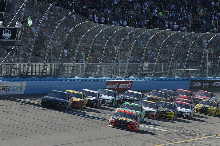 Martin Truex Jr. (19) leads the field through Turn 4 on a restart during the NASCAR Cup Series auto race at Phoenix Raceway, Sunday, March 8, 2020, in Avondale (Ralph Freso/AP)