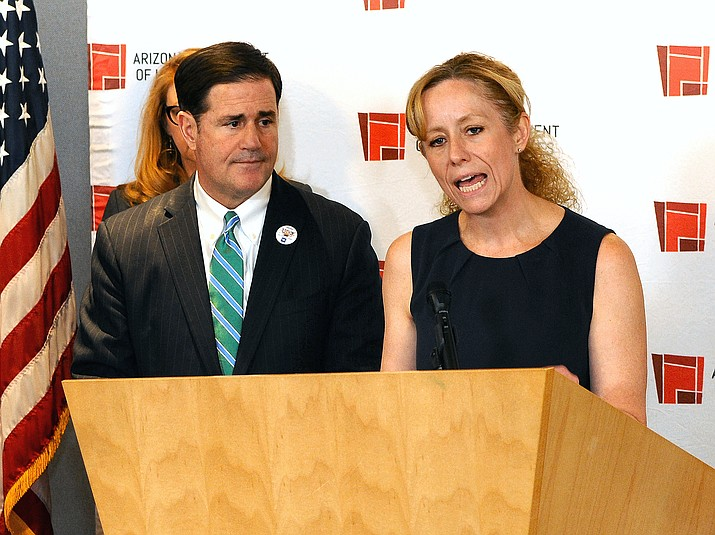 State Health Director Cara Christ details the risks of COVID-19 Monday to Arizona. With her is Gov. Doug Ducey. (Howard Fischer/Capitol Media Services)