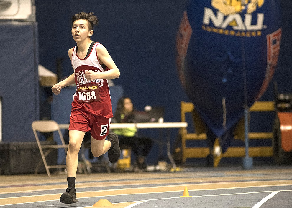 Heading into the home stretch, freshman Jafet Torres on the 800 meter. Torres threw himself over the finish line to beat his opponent. (V. Ronnie Tierney/WGCN)