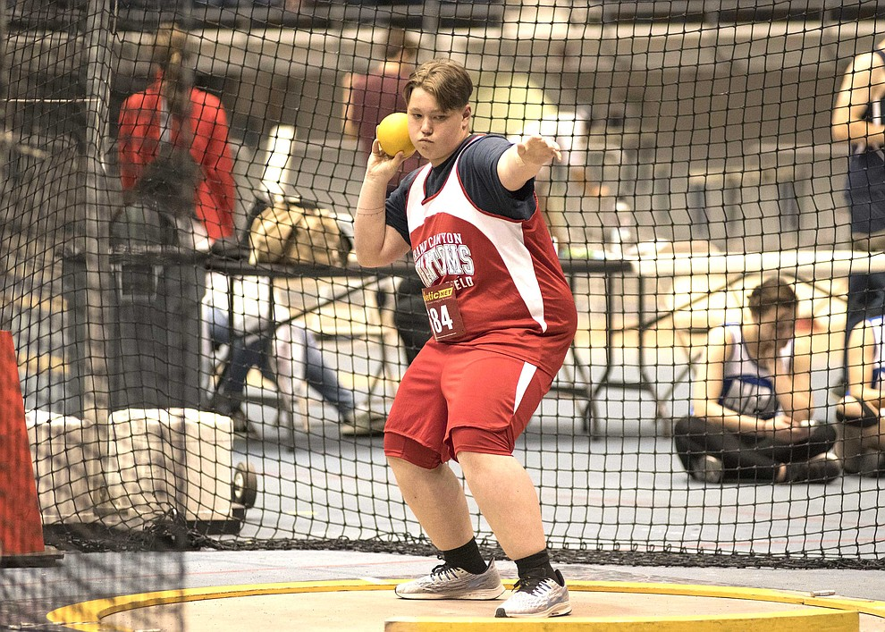 Sophomore Austin Norris-Woods gets down into a stance to throw the shot put. (V. Ronnie Tierney/WGCN)